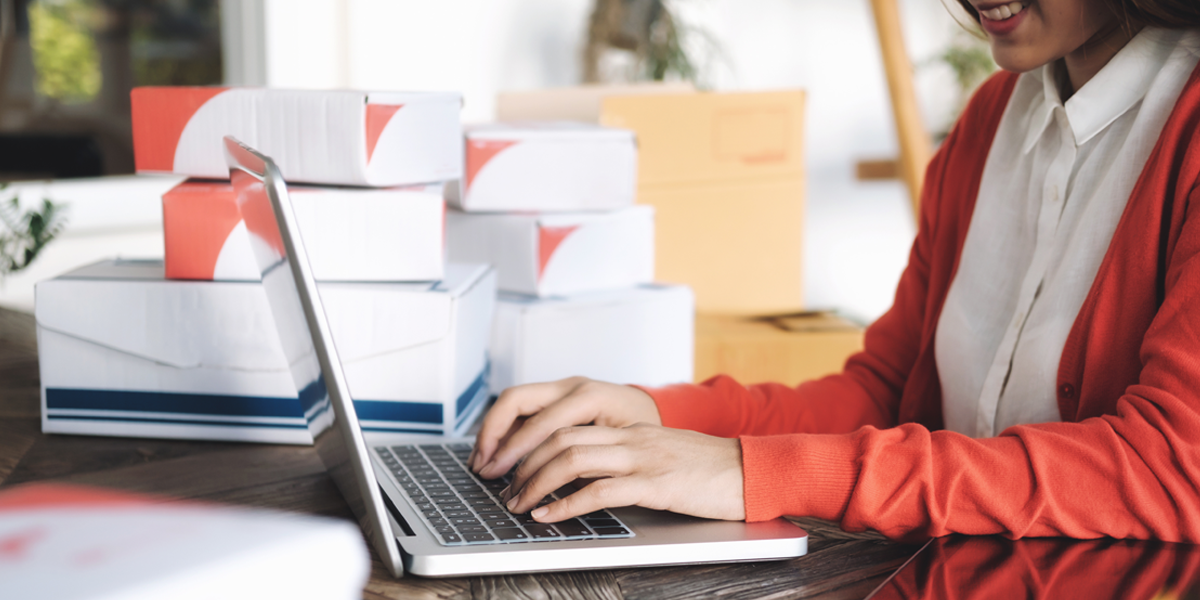 Woman using laptop to manage ecommerce sales and fulfillment