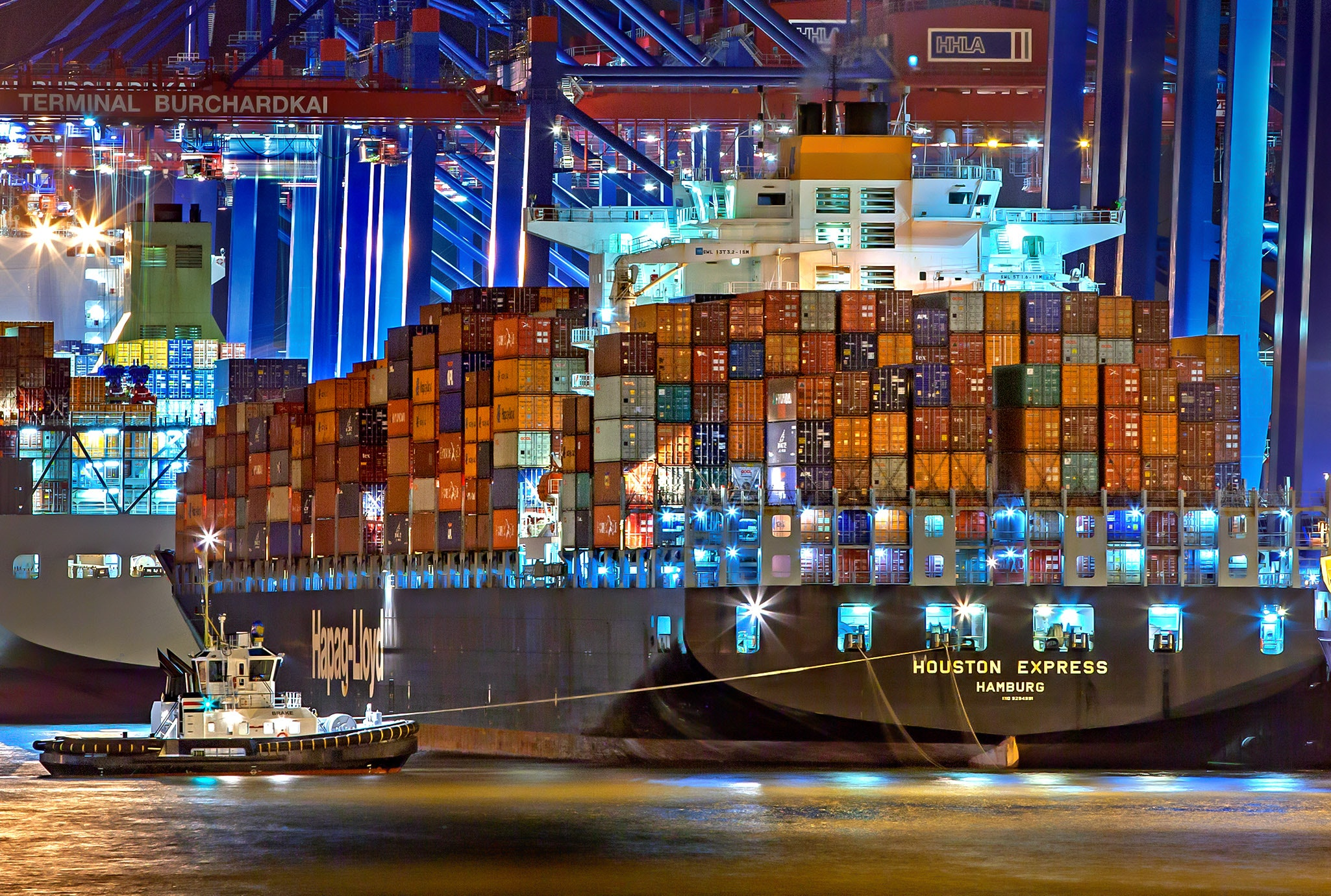 A cargo ship in the middle of the sea at night